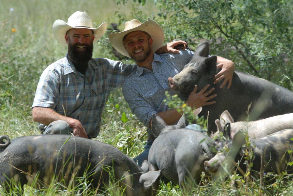 A photo of Toby McPartland and Hayden Kessel Colorado Pastured Pork Farmers